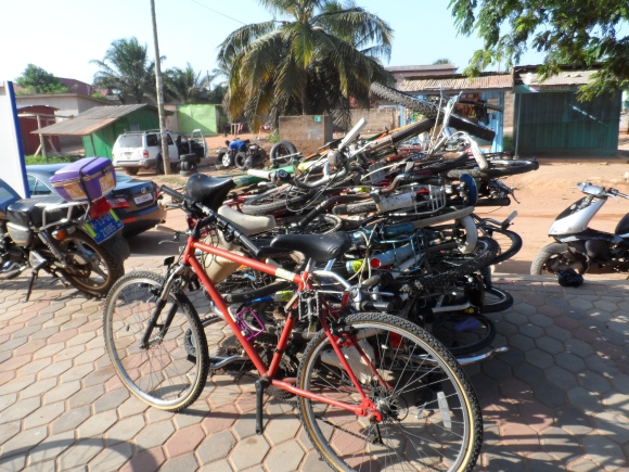 As the container unloads, the buyers stack the bikes they want to buy in a pile and then wait to negotiate the price at the end.