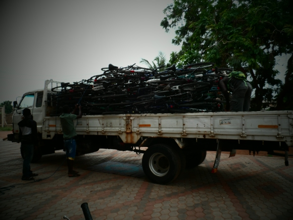 Truck loaded with 100 bikes headed out to the bush.